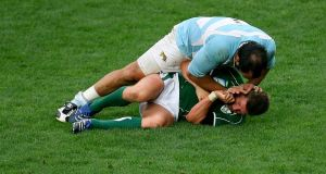 Ieland's Ronan O'Gara has his face pushed into the ground by Argentina's Juan Martin Scelzo during the fractious 2007 World Cup clash in Paris. Photograph: Dan Sheridan/Inpho