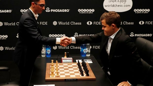 Magnus Carlsen and Fabiano Caruana before the first game. Photograph: Paul Childs/Reuters