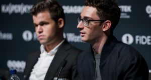 Magnus Carlsen and Fabiano Caruana attend the press conference of the FIDE World Chess Championship. Photograph: Tristan Fewings/Getty Images