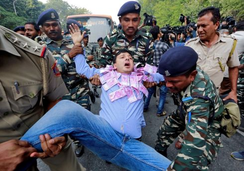 INDIAN PROTEST: Police detain a supporter of India's main opposition Congress Party during a protest to mark two years since demonetisation, in New Delhi. Photograph: Altaf Hussain/Reuters