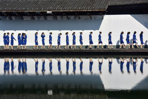 CONFERENCE CALL: Attendants for the fifth World Internet Conference are seen during a photo session outside the venue, in Jiaxing, Zhejiang province, China. Photograph: Stringer/Reuters
