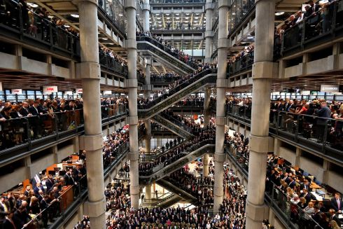 ARMISTICE DAY: Workers stand during a remembrance service at the Lloyd's building in the city of London, Britain, ahead of Armistice Day. Photograph: Toby Melville/Reuters