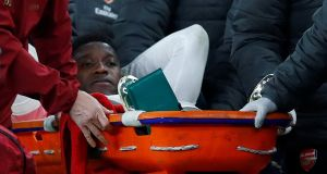 Danny Welbeck leaves the pitch on a stretcher after sustaining an injury. Photograph: Eddie Keogh/Reuters