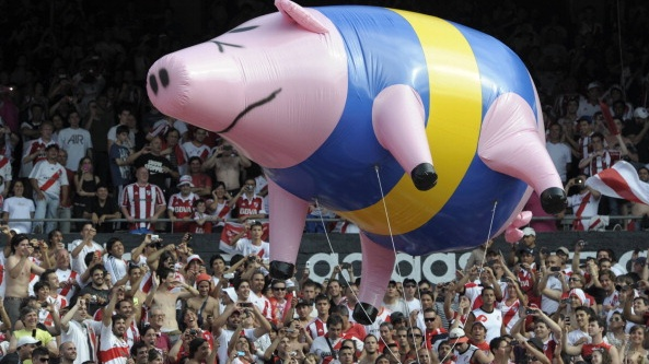 River Plate supporters fly an inflatable pig with the colours of Boca Juniors in 2012. Photograph: Juan Mabromata/Getty Images