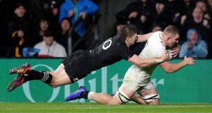 Beauden Barrett of New Zealand tackles Sam Underhill of England as he scores a try that was  later disallowed during the autumn international  at Twickenham. Photograph:  Henry Browne/Getty Images