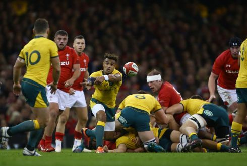 Australia scrumhalf Will Genia passes the ball during the Test match against Wales at the Principality stadium in Cardiff. Photograph: Geoff Caddick/AFP/Getty Images