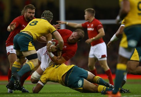 Wales lock Alun Wyn Jones is tackled by Australia number eight David Pocock at the Principality stadium in Cardiff. Photograph: Geoff Caddick/AFP/Getty Images
