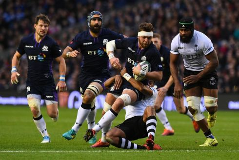 Scotland flanker Ryan Wilson is tackled during the Test match against Scotland at Murrayfield. Photograph: Andy Buchanan/AFP/Getty Images