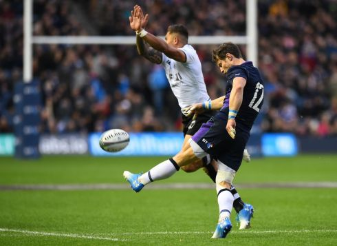 Scotland centre Pete Horne kicks  during the Test match against Fiji at Murrayfield. Photograph:Andy Buchanan/AFP/Getty Images
