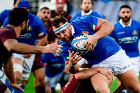 Italy's prop Andrea Lovotti  is tackled during the Test match in Florence. Photograph: Filippo Monteforte//AFP/Getty Images