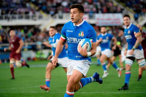Italy's outhalf Tommaso Allan  on his way to score a try during the Test match against Georgia in Florence. Photograph: Filippo Monteforte//AFP/Getty Images
