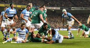 Bundee Aki  scores Ireland's second  try during the autumn international against Argentina at the Aviva stadium. Photograph:  Charles McQuillan/Getty Images