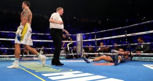 Tony Bellew on the canvas after being knocked out by Oleksandr Usyk in Manchester. Photograph: Richard Heathcote/Getty