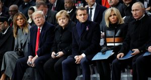 US president Donald Trump and first lady Melania Trump, German chancellor Angela Merkel, French president Emmanuel Macron and his wife Brigitte, and Russian president Vladimir Putin attend a commemoration ceremony for Armistice Day, 100 years after the end of the First World War, at the Arc de Triomphe, in Paris. Photograph: Francois Mori/Pool via REUTERS