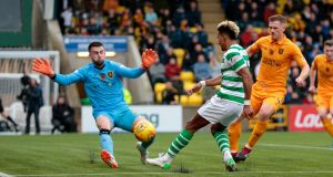 Scott Sinclair sees a shot saved by Livingston goalkeeper Liam Kelly during Celtic's goalless draw. Photograph: Graham Stuart/PA