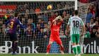 Barcelona goalkeeper  Marc-Andre ter Stegen fumbles the ball as Giovani Lo Celso scores Real Betis' third goal in the La Liga game ay the Nou Camp. Photograph:  Albert Gea/Reuters