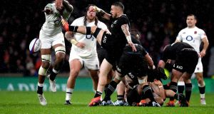 England's Courtney Lawes  charges the ball down from TJ Perenara of New Zealand   at Twickenham Stadium on Saturday in London, United Kingdom. Photograph: Shaun Botterill/Getty Images