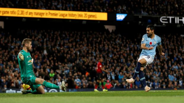 Manchester City's Ilkay Gundogan scores their third goal in the Premier League match against Manchester United at the Etihad stadium . Photograph: Darren Staples/Reuters