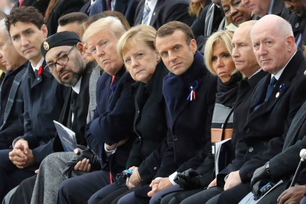From left; Canadian Prime Minister Justin Trudeau, Morocco's Prince Moulay Hassan, Moroccan King Mohammed VI, US First Lady Melania Trump, US President Donald Trump, German Chancellor Angela Merkel, French President Emmanuel Macron and his wife Brigitte Macron, Russian President Vladimir Putin and Australian Governor-General Peter Cosgrove attend a ceremony the Arc de Triomphe in Paris, France, as part of the commemorations marking the 100th anniversary of the 11 November 1918 armistice, ending the first World War on Sunday, November 11th Photograph: Ludovic Marin/AP/Pool