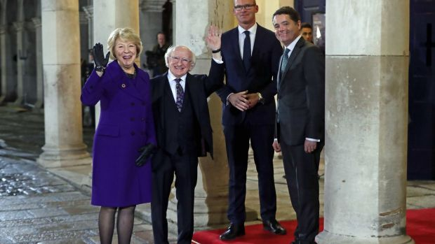 Michael D Higgins and his wife Sabina are greeted by Tánaiste Simon Coveney and Minister for Finance Paschal Donohoe at Dublin Castle. Photograph: Niall Carson/PA Wire