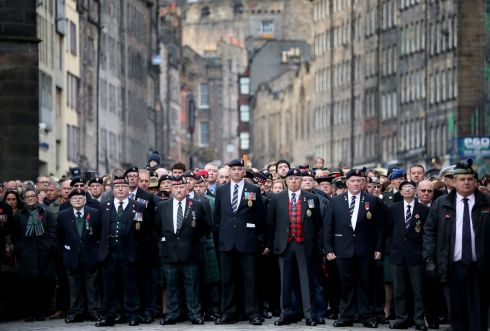 Veterans stand on the Royal Mile during a ceremony at the City Chambers, Edinburgh, on the 100th anniversary of the signing of the Armistice which ended the first World War. Photograph: Jane Barlow/PA Wire