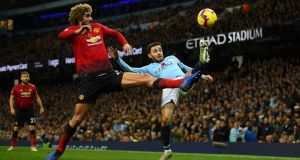 Marouane Fellaini of Manchester United battles for possession with Bernardo Silva of Manchester City   at Etihad Stadium on Sunday. Photograph:  Mike Hewitt/Getty Images