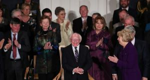 Michael D Higgins gets a standing ovation at his inauguration at Dublin Castle. Photograph: Maxwells/PA Wire
