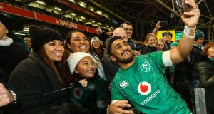 Bundee Aki celebrates with his fmaily after Ireland's win over Argentina. Photograph: Dan Sheridan/Inpho