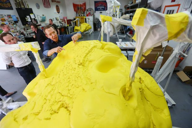 Almost all successful artists have assistants: Jeff Koons directs painting work on his piece Play-Doh, in 2014. Photograph: Chang W Lee/New York Times