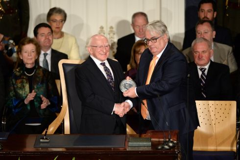 President Higgins receives the seal of office from Chief Justice Frank Clarke. Photograph: Dara Mac Donaill