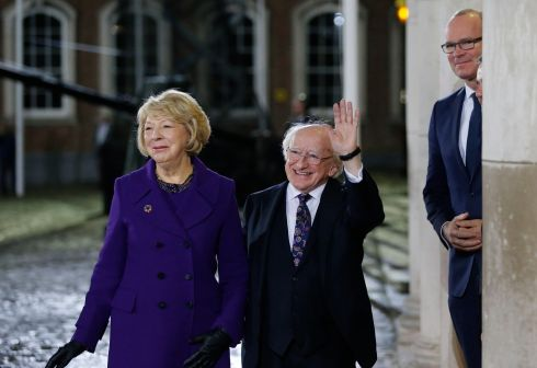 The scene at Dublin Castle: Mr Higgins waves alongside  Sabina (left) and Tánaiste Simon Coveney (right). Photograph: Nick Bradshaw