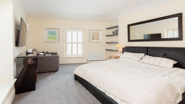 Large ensuite and walk-in wardrobe give the main bedroom at 4 Sussex Terrace the wow factor