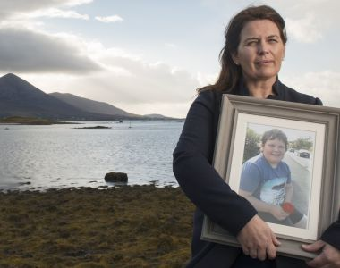 "Olga Kennedy holds a photograph of her late son Oisín: ""It's wrong that when a 12-year-old cancer patient's right to confidentiality is ignored, the most you can expect is 'sorry'."" Photograph: Michael McLaughlin"