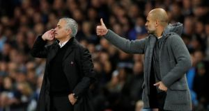 Manchester City manager Pep Guardiola and Manchester United manager José Mourinho. United's season is now about catching up with two of Liverpool, Chelsea, Tottenham and Arsenal to force their way into the Champions League qualification spots. Photograph: Darren Staples/Reuters