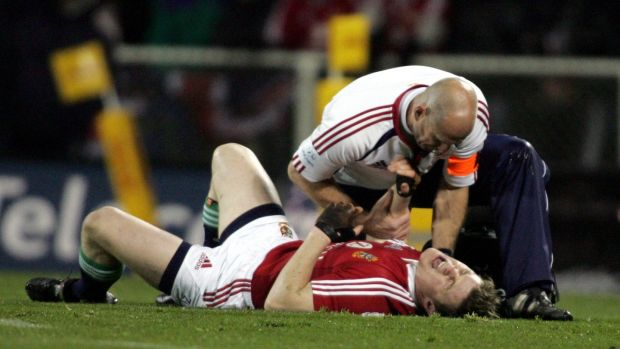 O'Driscoll is treated before leaving the field with a dislocated shoulder. Photo: Hannah Johnston/Inpho