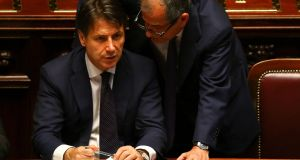 Italian prime minister Giuseppe Conte with finance minister Giovanni Tria in June. Photograph: Tony Gentile/Reuters