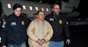 "Joaquín ""El Chapo"" Guzmán being taken from a place in New York by US law enforcement on January  19th, 2017. Photograph: US law enforcement via AP"