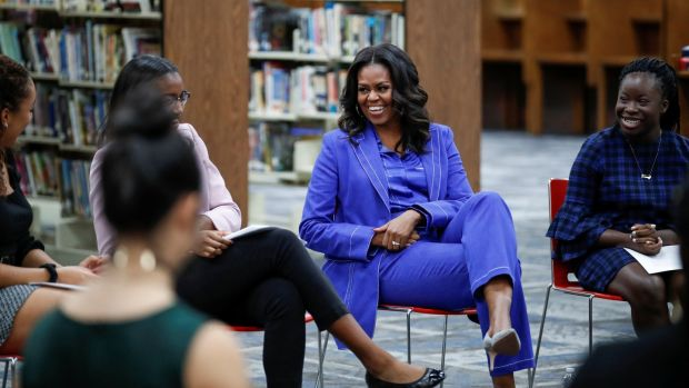 Michelle Obama beginning her book tour with a stop at the Whitney M Young Magnet High School in Chicago on Monday. Photograph: Kamil Krzaczynski/Reuters
