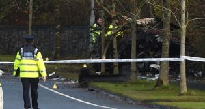 Garda forensic collision investigators at the scene of the fatal crash on the Killala Road in Ballina, Co Mayo,   in which two young men died. Photograph: David Farrell