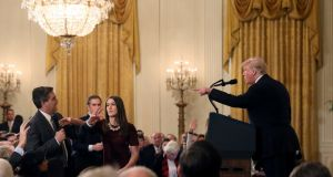 A White House staff member reaches for the microphone held by CNN's Jim Acosta as he questions US president Donald Trump during a news conference last week. Photograph: Jonathan Ernst/Reuters