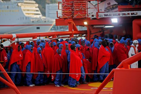 Migrants, intercepted off the coast in the Mediterranean Sea, wait to disembark from a rescue boat after arriving at the port of Malaga, southern Spain. Photograph: Jon Nazca/Reuters