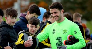 Ireland's Robbie Brady poses for a picture with a young fan during training ahead of the friendly with Northern Ireland. Photo: Ryan Byrne/Inpho