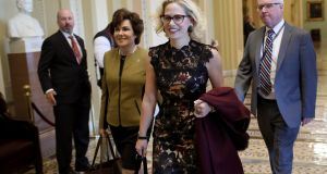 Democratic senators-elect Kyrsten Sinema  and Jacky Rosen  walk to the office of Senate minority leader Chuck Schumer for a meeting at the US Capitol on Tuesday.   Photograph:  Win McNamee/Getty Images