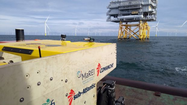 "'Clean Energy' showcases the University of Limerick underwater submersible 'ROV Etáin' about to complete an inspection on one of the largest offshore wind farms in the UK. In the UK, offshore wind is now cheaper than nuclear and ""new gas"" and as Ireland targets 70 per cent renewable electricity by 2030, offshore wind looks set to play a pivotal role in reaching this goal. Photograph: Gerard Dooly, UL research fellow"
