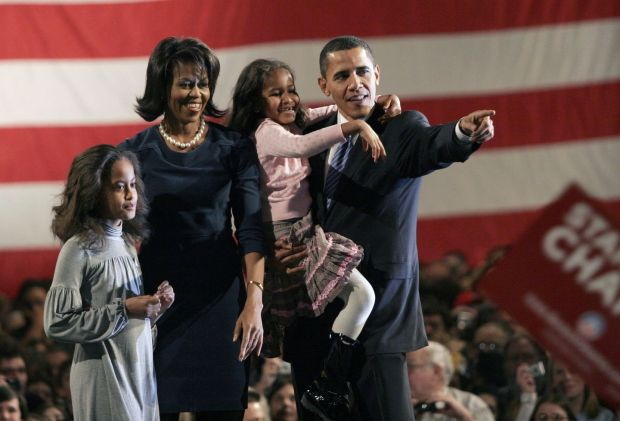 Barack Obama, right, campaigning for the US presidency in 2008, with 2 his wife Michelle and their daughters Malia, left, and Sasha. Photograph: Ryan Anson/Bloomberg News