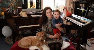 "Composer and multi-media artist Una Keane with her daughter Willow and dog Indie: ""Experiences are now more important to me than things. I can live without this stuff."" Photograph: Dara Mac Dónaill"