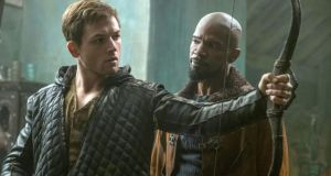 """Obviously on set you can't have real arrows flying around."" Above, Taron Egerton with Jamie Foxx in Robin Hood"