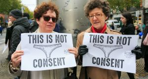 Florence Conroy and  Eileen Solan are pictured during a protest at the Spire on O'Connell Street in Dublin over victim blaming in the courts. Photograph: Gareth Chaney/Collins.