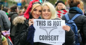 Alex McElroy and Abigail Poynton during a protest at the Spire on O'Connell Street in  Dublin over victim blaming in the courts. Photograph: Gareth Chaney/Collins.