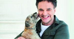 "Noel Fitzpatrick with his dog Keira, his 'closest friend""."